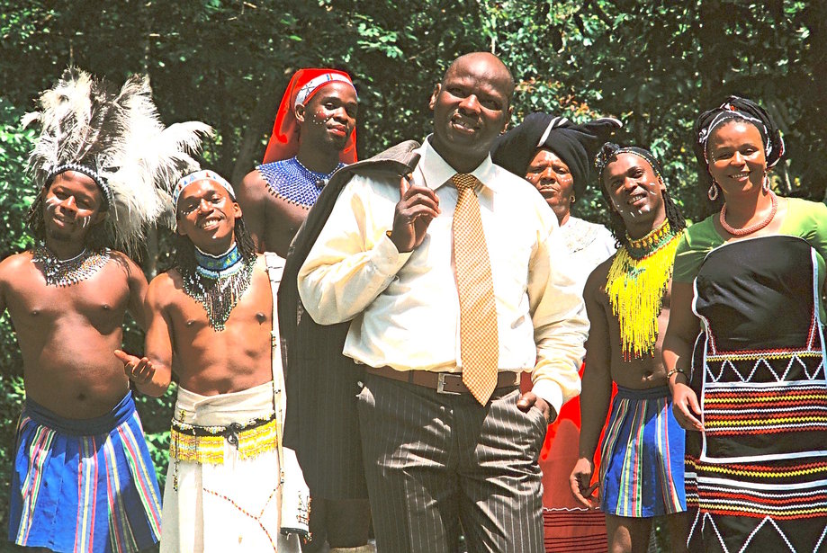 True African music practitioners . . . a suited Dizu Plaatjies with members  of his band. Photo: P. Lee-Thorp